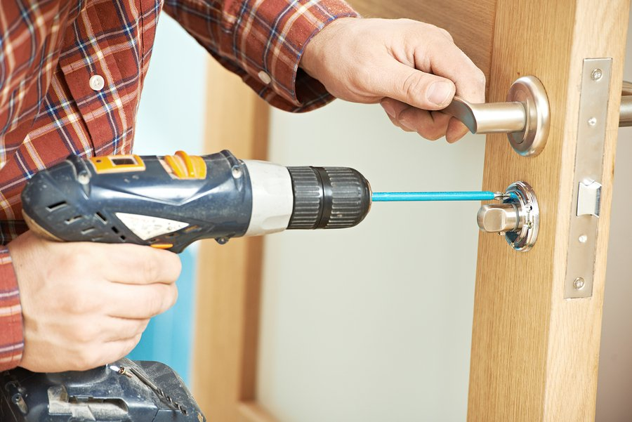 carpenter installing a door lock