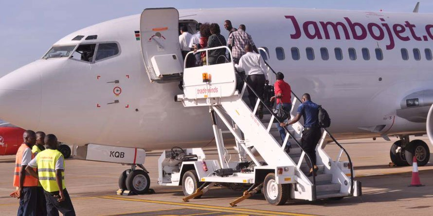 Travellers board a Jambojet plane