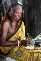 Grandmother busy making a mat for the family. Location: Sunderbans