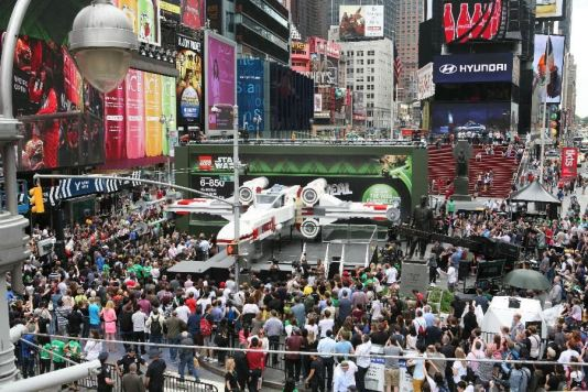 Thousands gather in New York City's Times Square to watch the unveiling of the world's largest LEGO Model, a 1:1 replica of the LEGO Star Wars X-wing Starfighter that took 32 Model Builders, 5.3 million LEGO bricks and over 17,000 hours to complete, Thursday May 23, 2013. (Amy Sussman/AP Images for The LEGO Group)