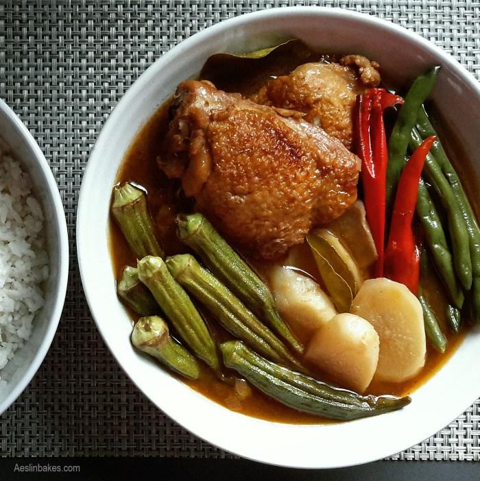 bowl of Sinigang na Manok with rice - main dishes