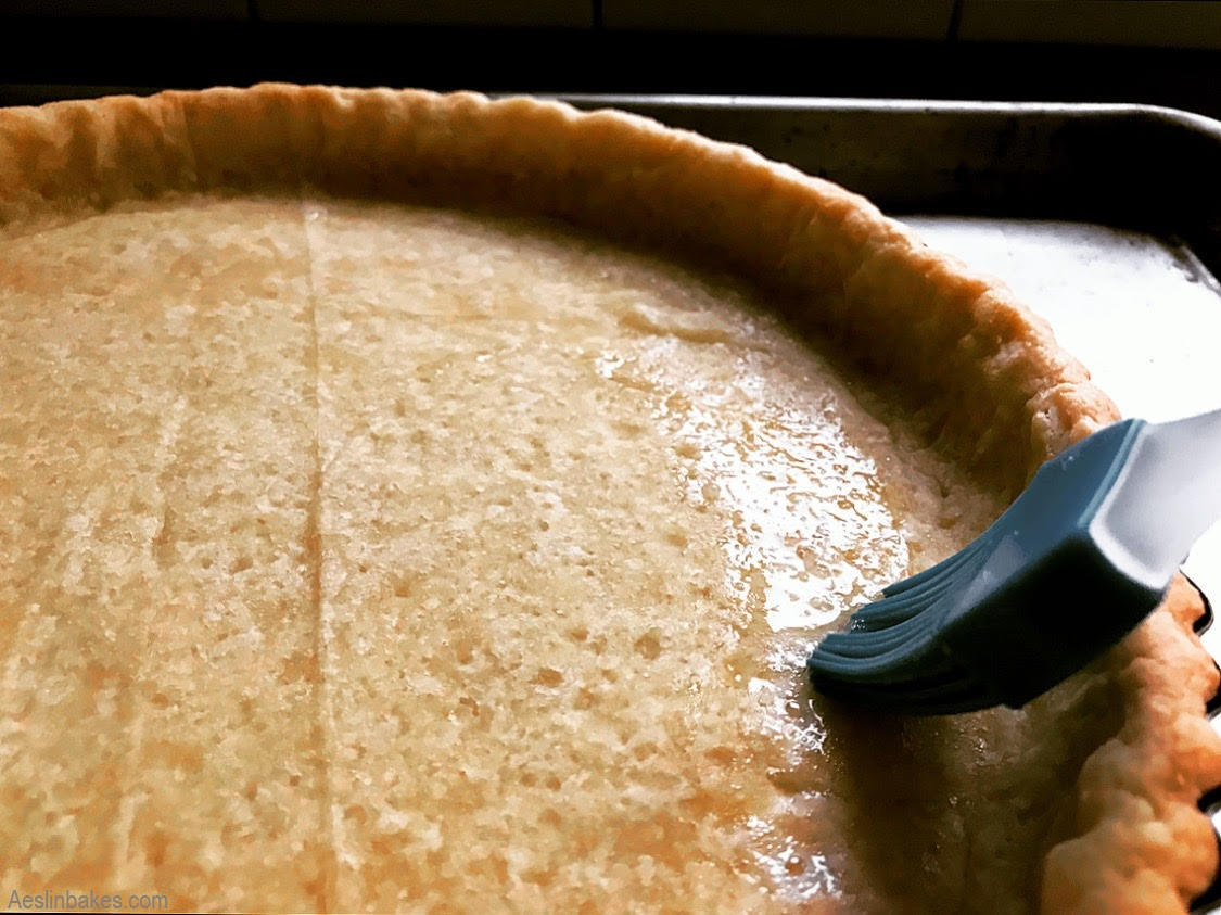 brushing sweet pastry with egg white