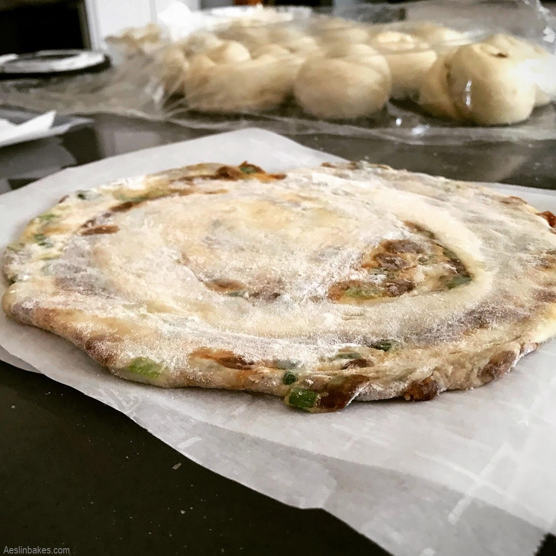 rolled out scallion pancake on parchment