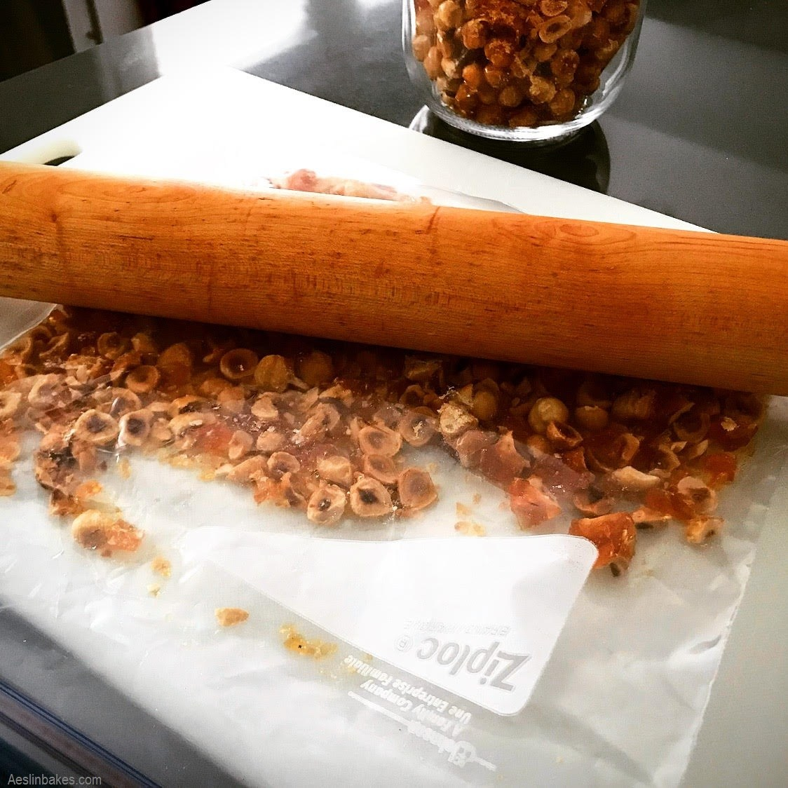 smashing brittle with a rolling pin