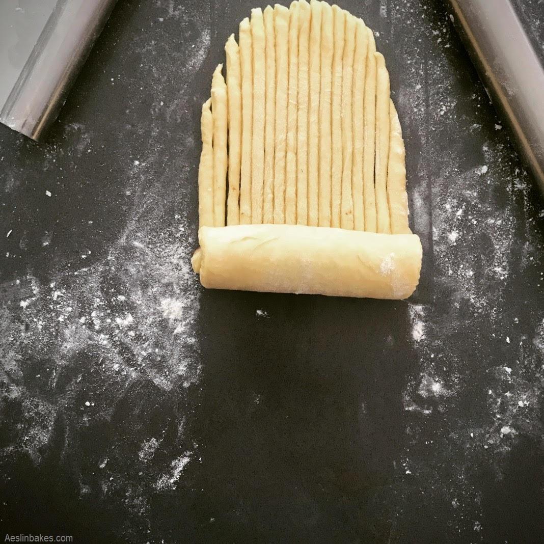 brioche wool roll loaf segment being rolled halfway