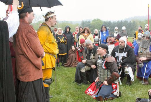 THLord Arnthor inn Sterki receives a Writ for the Chivalry. Photo by Caoilfhionn of the Woods.