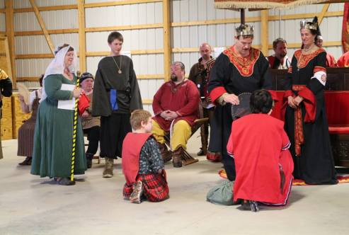 Henry and Ulf are invested as Youth Champions. Photo by Master Alaxandair O'Conchobhair.