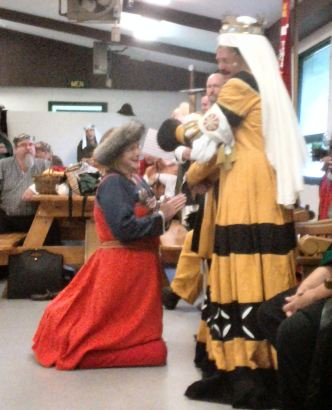 Mistress Ysabell Graver receives a Golden Alce.