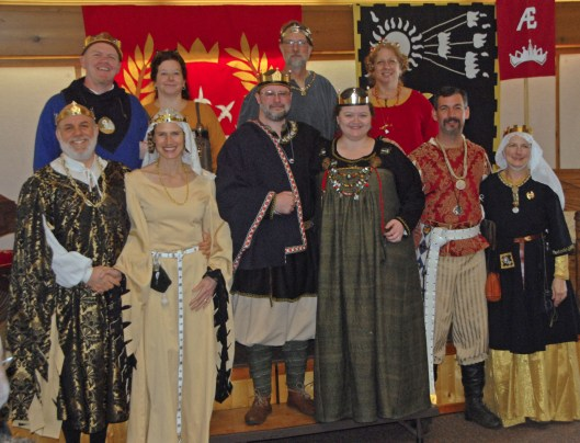 Former and current Barons of the Debatable Lands: Back row: Baron Liam and Baroness Constance, Baron Langdon and Baroness Ardis. Front row: Prince Byron and Princess Ariella, Baron Brandubh and Baroness Hilderun, Baron Alonzio, and Countess Genevieve. Photo by Mistress Ts'vee'a