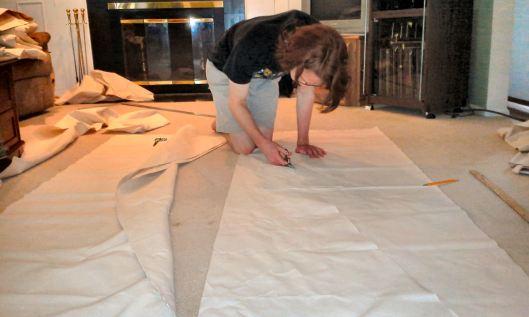 Robert cutting canvas