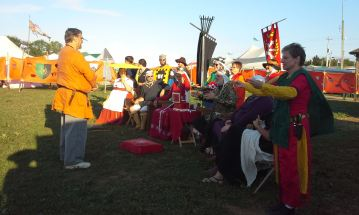Master Urho receives his Jewel scroll. Photo by Arianna of Wynthrope.