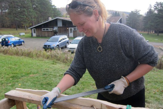 Hard at work rasping and shaping the sides and handle of the bow 'sculpture'.