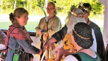 Lady Thalia receives her AoA. Photo by Lord Mikus Magellus.