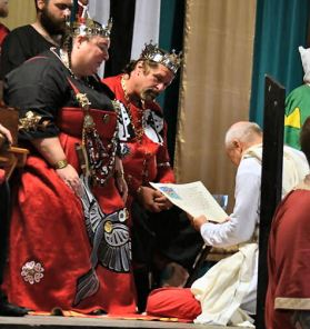 Master Tofi seeks an honest person, then receives an Augmentation of Arms. Photo by Baron Steffan.
