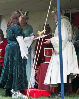 Lady Rachelle is awarded Arms. Photo by Jinx.