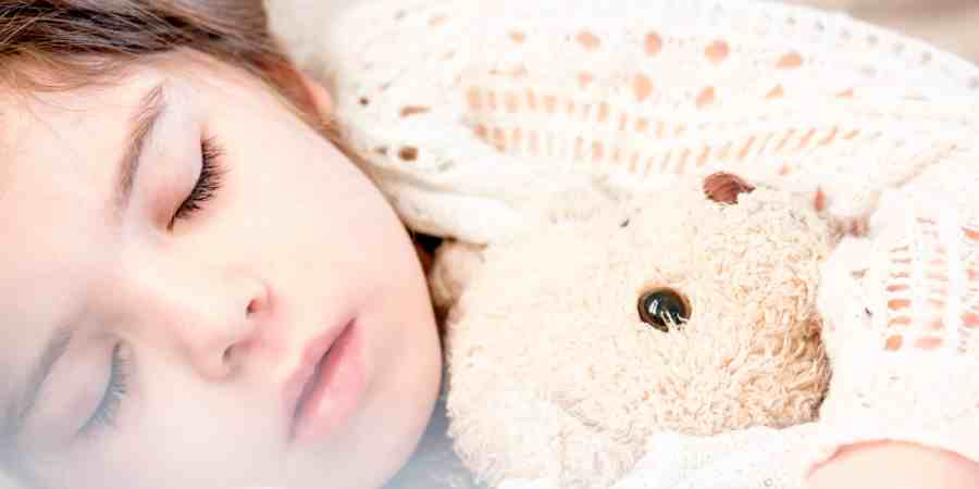 Keep kids healthy like this little girl sleeping peacefully with her teddy bear.