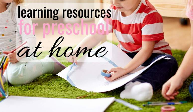 little boy on the floor using learning resources while doing preschool at home