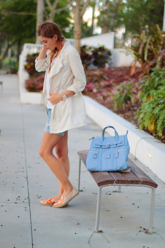 a fancy affair blog miami fashion and beauty blogger amanda tur henri bender large blue jetsetter backpack tory burch orange espadrilles beige trench coat distressed shorts silver coin and turquoise necklace messy fishtail braid