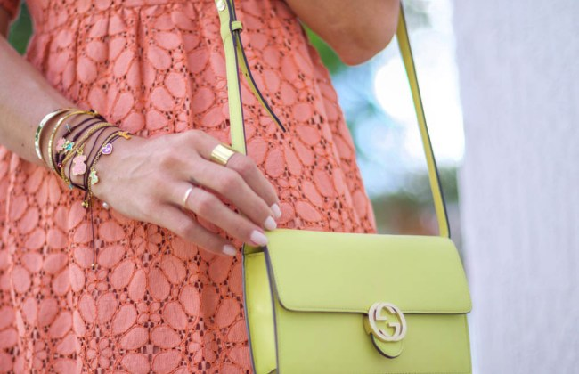 Miami Fashion Blogger Amanda Tur from A Fancy Affair wore a coral lace knee length midi dress paired with the Adalyn Marc Fisher ltd platform wedges and Face tous collection layered necklace and bracelets with Daniel Wellington classic brown leather watch and tous chocker and Gucci WOC wallet on chain lime green yellow bag