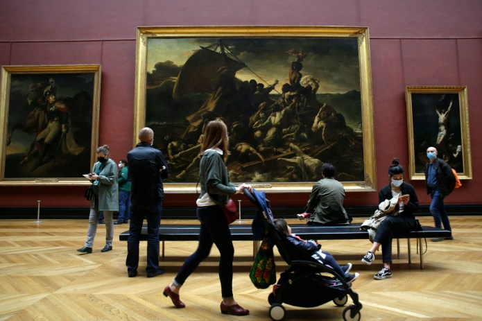 Visitors were eager to enter the Louvre in Paris when it reopened on May 19.