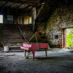 Abandoned theatre with pink baby grand piano