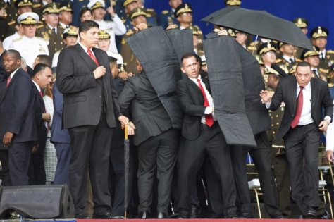 Maduro's security detail reacts to safeguard him from additional detonations.