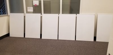 whiteboards in a line