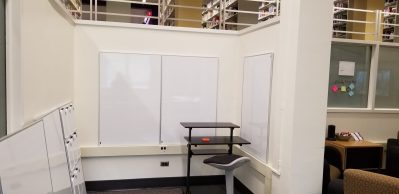 whiteboards on the wall with standup desk