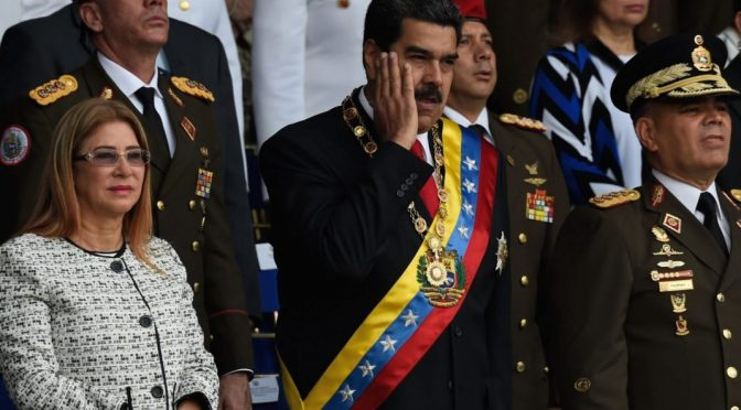Nicolas Maduro reacts during a ceremony attacked by drones.