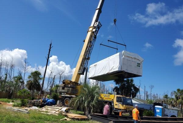 modular home being set with crane