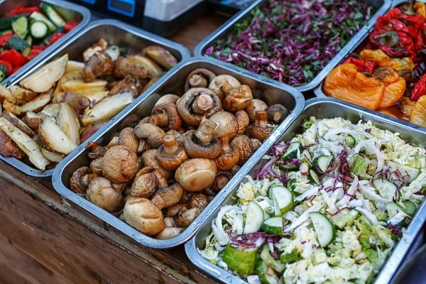 Catering Food Buffet with grilled mushrooms, potatoes, and assorted veggies