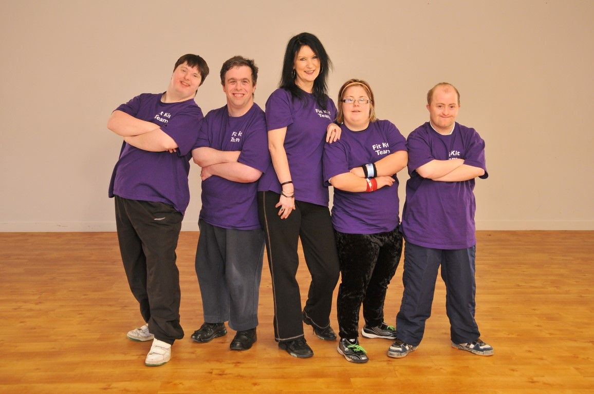 Five people in purple T-shirts that say Fit Kit Team