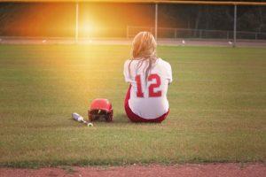 Teenager on softball pitch