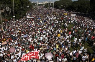 Thousands of believers take part in the annual 'March for Jesus' parade in Sao Paulo, Brazil, on June 29, 2013. AFP PHOTO / Daniel GUIMARAES