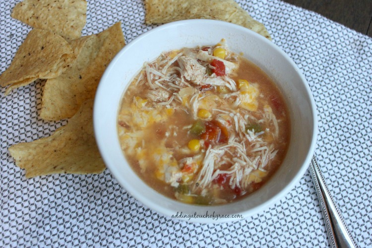 This chicken tortilla soup recipe is so simple and delicious.  Made in the Crock Pot, it's bursting with flavor and perfect for these cool fall evenings.
