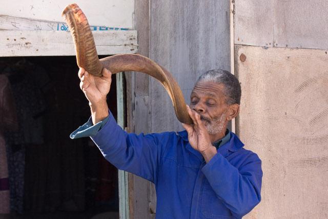 Nama man blowing a greeting