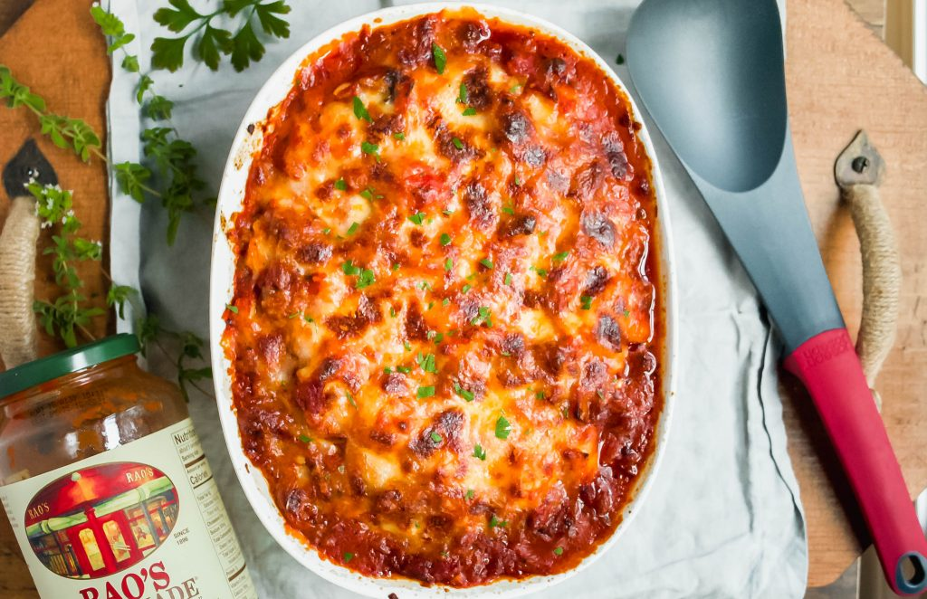 the ultimate comfort food. rich, baked gnocchi is packed with bacon, sausage, fresh herbs and mozzarella for the best baked pasta dish you'll have this fall! bacon + sausage + tomato sauce baked gnocchi | a flavor journal food blog