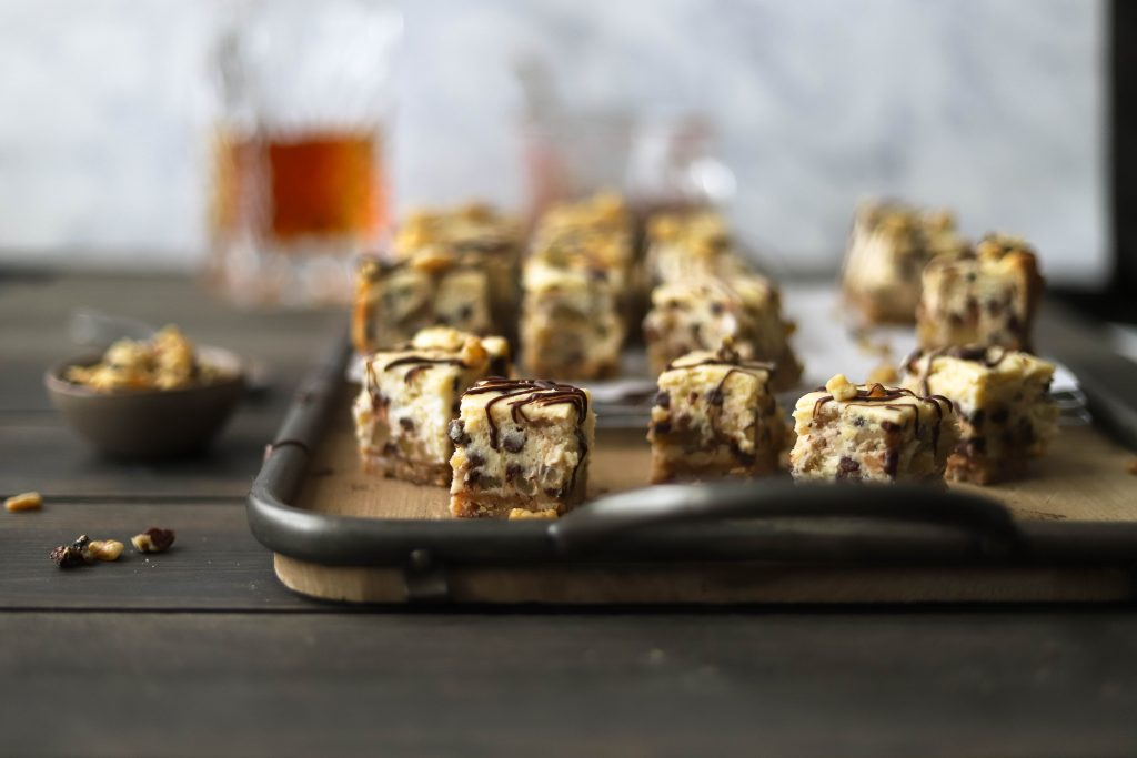 creamy cheesecake, bourbon, chopped walnuts, and chocolate chips make the best party food dessert to serve at your Derby party! derby bourbon cheesecake bites | a flavor journal food blog