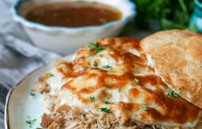 slow cooker shredded pork french dip sandwiches are easy and delicious! Lean shredded pork topped, bubbly provolone, and savory au jus are a killer combo.   slow cooker shredded pork french dip sandwiches   a flavor journal