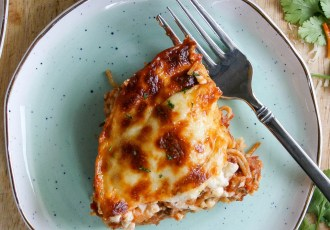 cheesy layered pasta bake combines hearty tomato sauce, hot italian sausage, and ground beef with layers of creamy, cheesy sauce! this pasta bake is topped with mozzarella cheese and baked to perfection. and instant family favorite! | a flavor journal