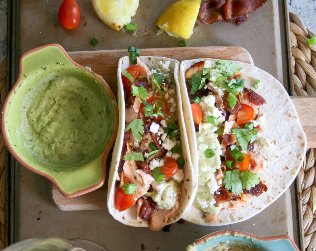 fresh salmon, seasoned with spices and olive oil, is pan-seared and flaked apart. with a little smoked bacon, feta cheese, and veggies - these make my favorite spicy salmon tacos! spicy salmon tacos : a small batch recipe for two | a flavor journal food blog