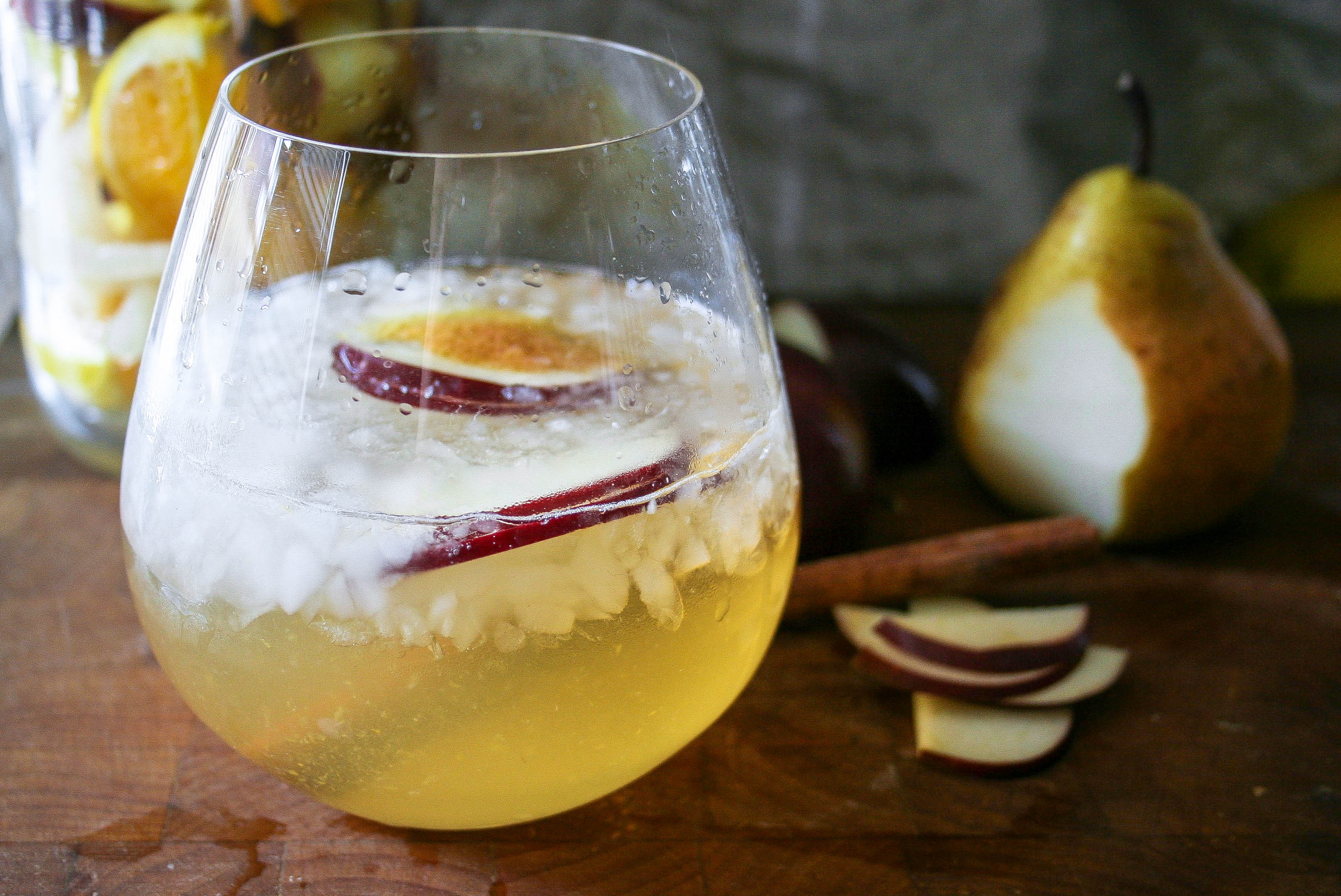 pears, apples, cinnamon, oranges, and honey combine with white wine to create a fruity fall sangria with a hint of warm spice. cheers! | fall sangria | a flavor journal food blog