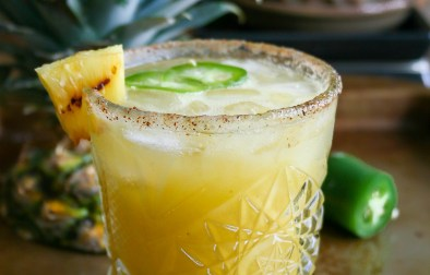 juicy grilled pineapple and spicy jalapeño are blended together for the ultimate sweet + heat margarita! so refreshing and a little spicy, this is the perfect margarita for summer! grilled pineapple and jalapeño margaritas | a flavor journal food blog