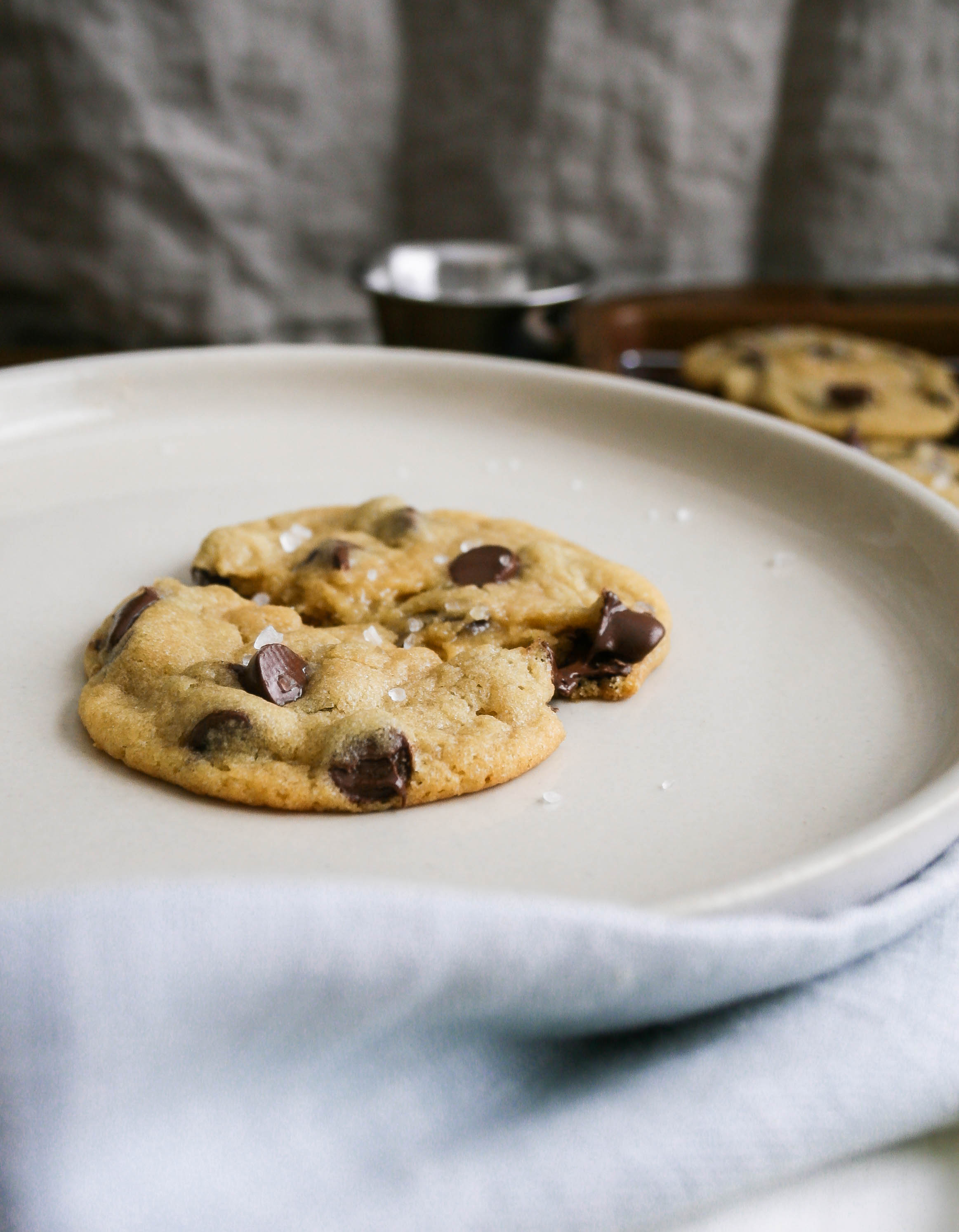 warm, gooey, classic chocolate chip cookies will melt in your mouth and warm your entire being. classic pantry staples, pure vanilla extract, and a touch of pure maple syrup bring a new depth to one of our childhood favorites. classic chocolate chip cookies | a flavor journal food blog