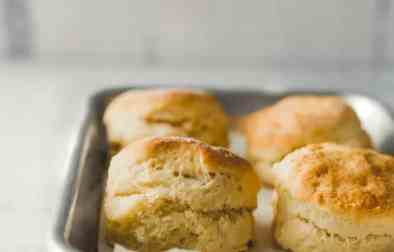 small batch homemade biscuits :: fluffy, flaky, homemade biscuits - small batch style. this recipe makes four biscuits, and a fifth biscuit with the dough scraps.