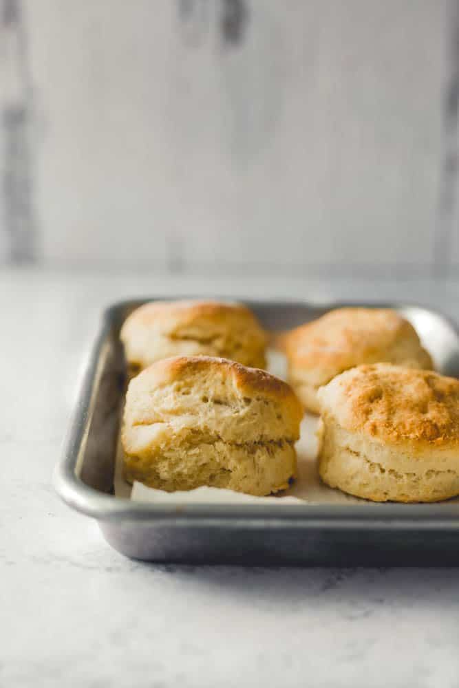 small batch biscuits :: fluffy, flaky, homemade biscuits - small batch style. this recipe makes four biscuits, and a fifth biscuit with the dough scraps.