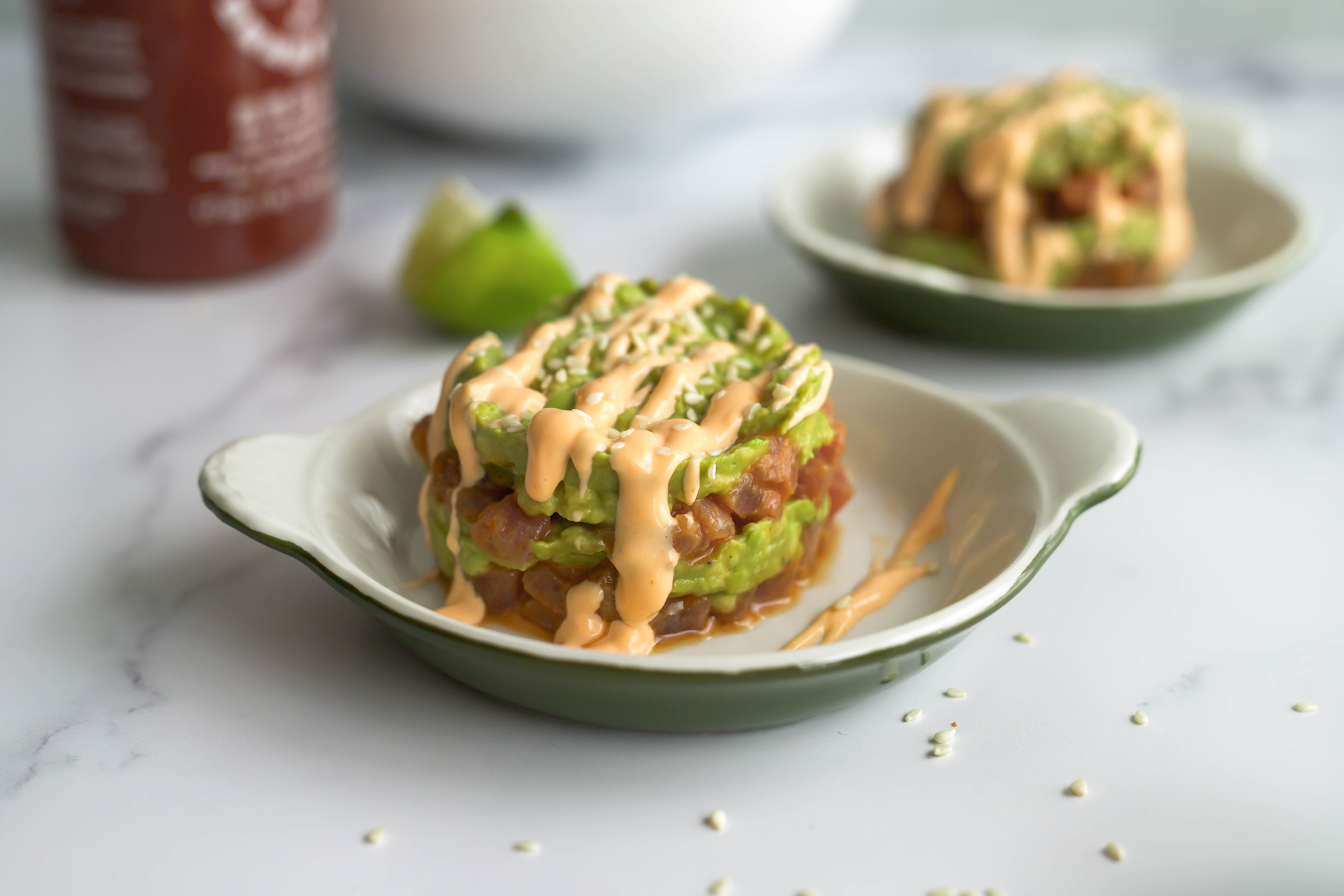 spicy tuna tartare and avocado stacks with wine pairings! spicy tuna, creamy avocado, and spicy lime drizzle makes these stacks so delicious but so easy! a flavor journal food blog