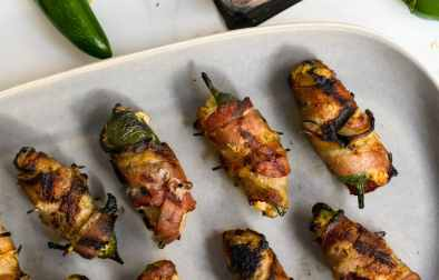 Grilled jalapeños stuffed with sausage and cheese bring the heat, the sweet, and the smokiness for a flavor bomb appetizer that's perfect for your next grilling night, or your next tailgate!