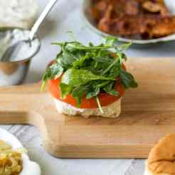 peppery arugula tossed in olive oil, salt and pepper for mini BLT sandwiches