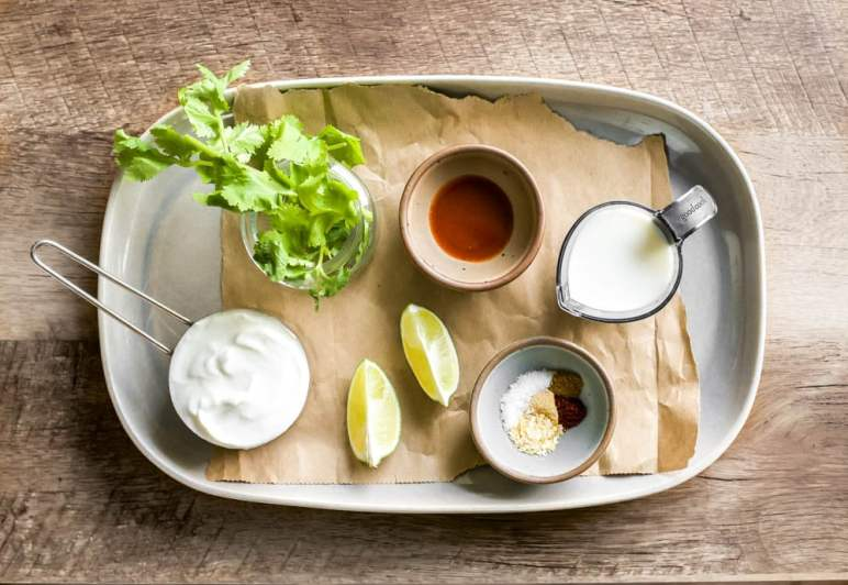 a quick and easy cilantro sauce with sour cream, fresh lime, cilantro, and spices